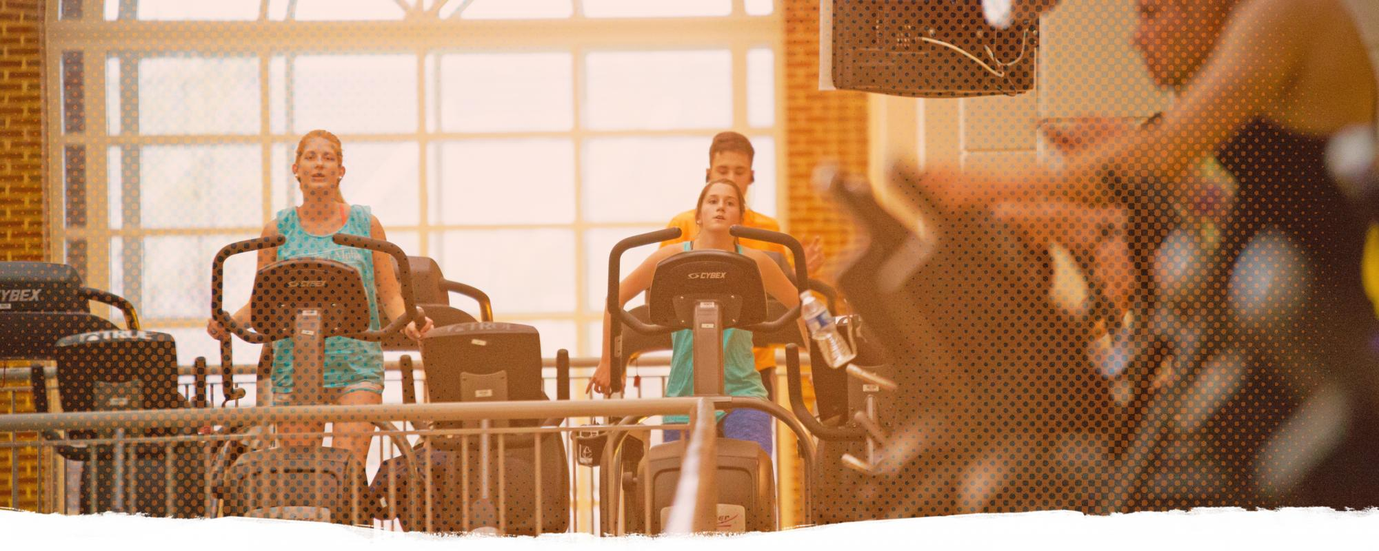 People working out on machines at the Aquatic and Fitness Center